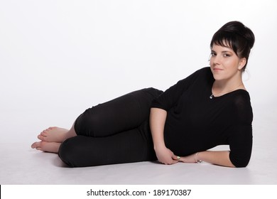 Young woman in black lying on the ground