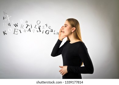 Young woman in black is screaming at something. Screaming and letters concept.