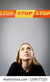 Young woman in black and and STOP line over her head. Restricted area concept.