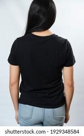 Young woman black t-shirt mockup, back view - hispanic t-shirt template