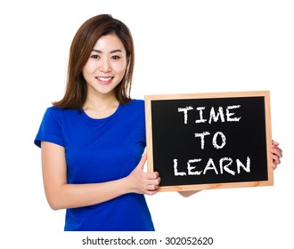Young woman with blackboard showing phrase of time to learn