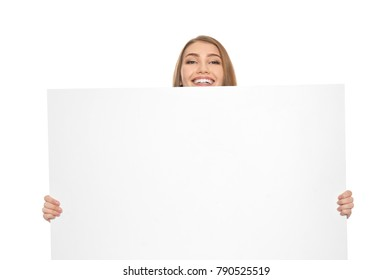 Young woman with blank advertising board on white background