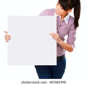 Young woman with blank board banner, isolated on white