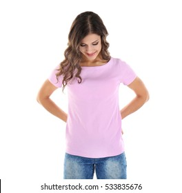 Young woman in blank color t-shirt on white background