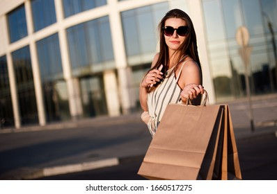 Young woman blogger go shopping to mall