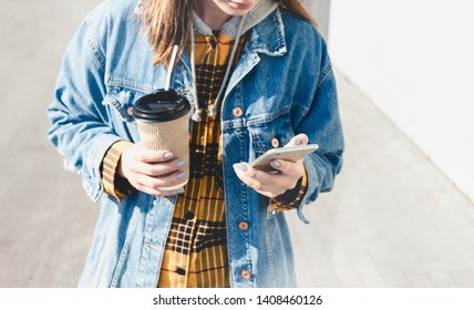 Young woman blogger texting on her phone on the street