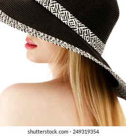 Young woman with blond long hair in hat isolated over white background
