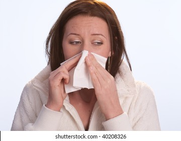 young woman blow one's nose