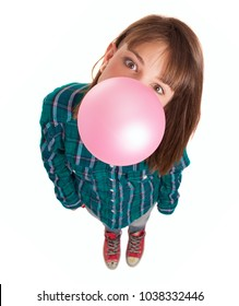 Young Woman Blowing Bubble Gum Over White Background