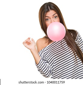 Young Woman Blowing Bubblegum against a white background