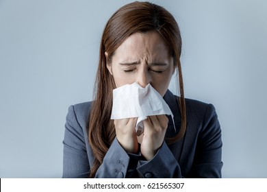 young woman blowing her nose. allergic rhinitis. hay fever.