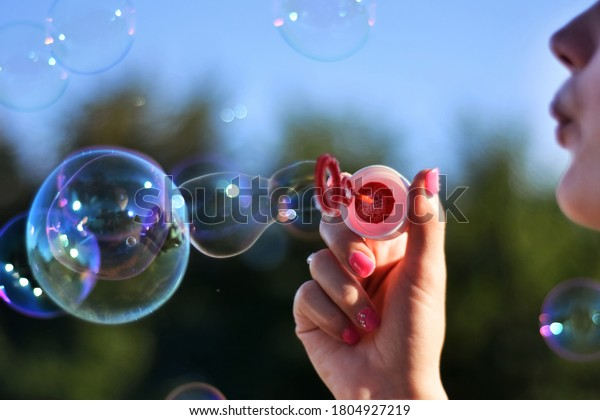 young-woman-blowing-soap-bubbles-600w-18
