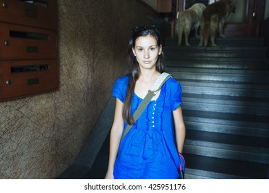 Young woman with blue dress