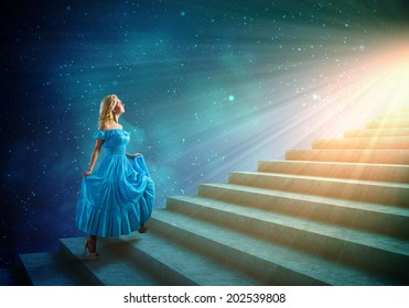 Young woman in blue dress walking up the stairs
