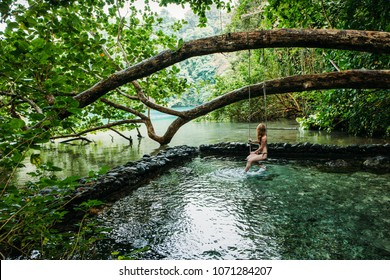 A young woman in blue lagoon in Jamaica