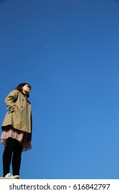 young woman blue sky.