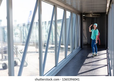 Young woman in the boarding bridge in the airport