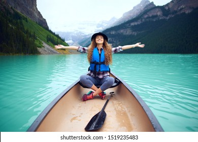 Young woman in boat on the lake Louise in Canada