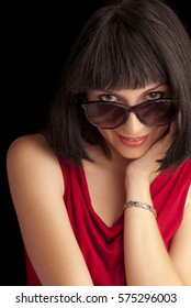 Young woman with bob hairstyle and retro sunglasses