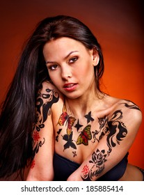 Young woman with body art . Studio shot.