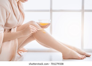 Young woman body care at home indoors