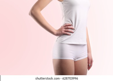 young woman body with cotton panties isolated
