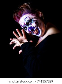young woman with body painting on her face, ugly scary clown, Halloween topic