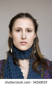 young woman in bohemian dress and blue scarf