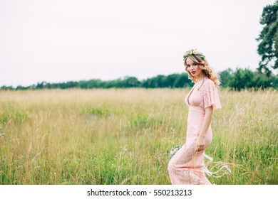 Young Woman In Boho Dress Standing On Meadow