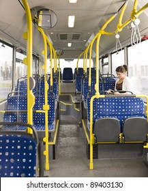 Young woman with a book alone on the bus