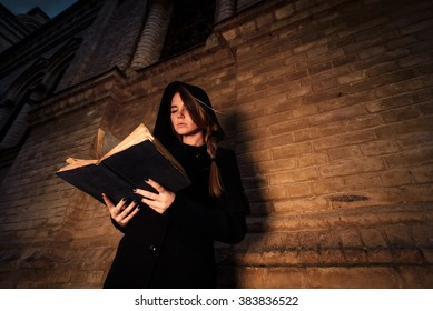 young woman with book in hands