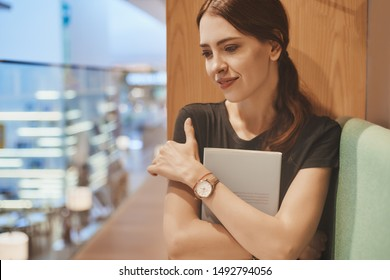 young woman with book in hands at the library lifestyle portrait