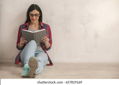 Young woman with a book studio portrait