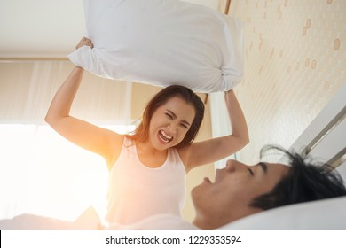 Young woman bored with her boyfriend snoring