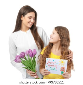 Young woman with bouquet of tulips and her daughter holding greeting card for Mother's day on white background