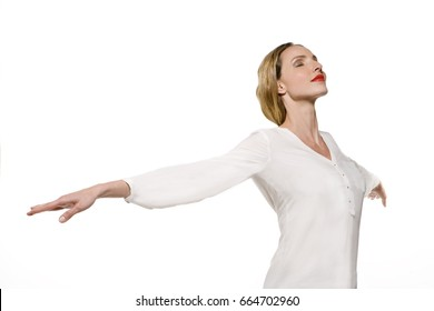 Young woman breathing and closing eyes, happy to relax and enjoying life