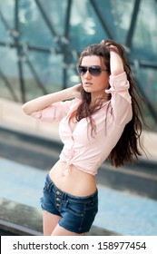 Young woman with brown hair, outdoor shoot