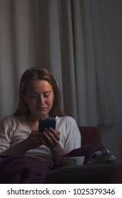 Young woman browsing the internet on your mobile phone and smile