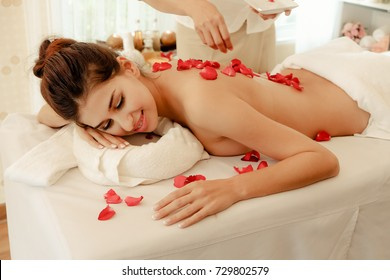 Young woman brunette skin relaxing in spa massage lie on your stomach