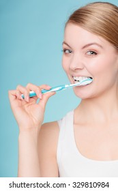 Young woman brushing cleaning teeth. Girl with toothbrush. Oral hygiene.