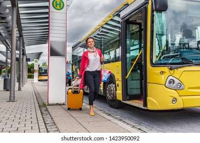 A young woman at bus and rail station