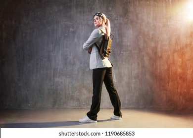 Young woman businesswoman with a jetpack on the back. Business acceleration concept, startup, technology and development