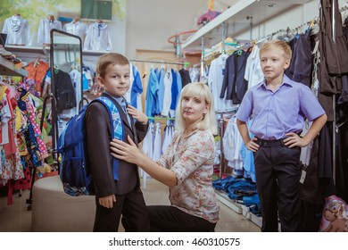 young woman buying clothes with the boys in school. Fees for school