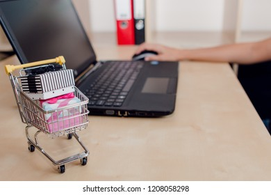 Young woman buying some gifts on Internet. Blackfriday and Cybermonday concept. Ecommerce sales.