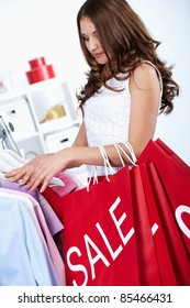 Young woman buying things at sales period