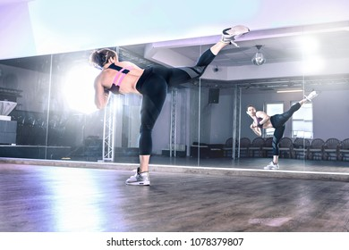 a young woman by piloxing or fitness exercise in the gym room
