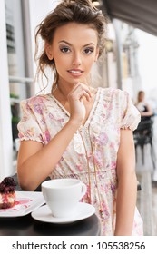 A young woman in a cafe. Outdoors