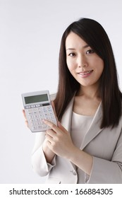 Young woman with calculator