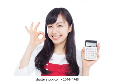 Young woman with calculator showing OK gesture, isolated on white background