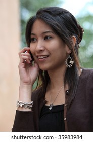 Young woman calling on her cell phone